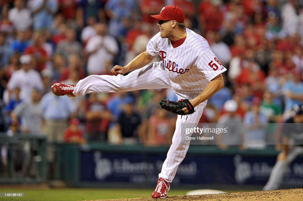 <a gi-track='captionPersonalityLinkClicked' href=/galleries/search?phrase=Jonathan+Papelbon&family=editorial&specificpeople=453535 ng-click='$event.stopPropagation()'>Jonathan Papelbon</a> #58 of the Philadelphia Phillies delivers a pitch in the ninth inning during the game against the Milwaukee Brewers at Citizens Bank Park on July 24, 2012 in Philadelphia, Pennsylvania. The Phillies won 7-6.