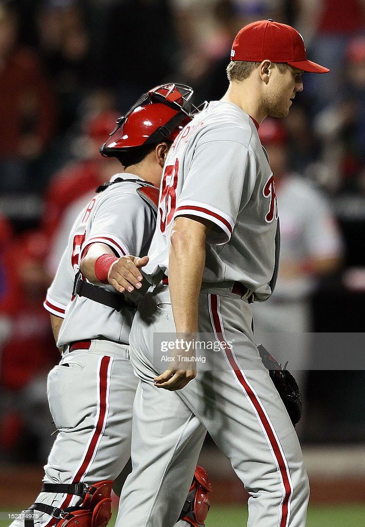 <a gi-track='captionPersonalityLinkClicked' href=/galleries/search?phrase=Jonathan+Papelbon&family=editorial&specificpeople=453535 ng-click='$event.stopPropagation()'>Jonathan Papelbon</a> #58 of the Philadelphia Phillies walks with Carlos Ruiz #51 of the Philadelphia Phillies after defeating the New York Mets 3-2 at Citi Field on September 19, 2012 in the Flushing neighborhood of the Queens borough of New York City.