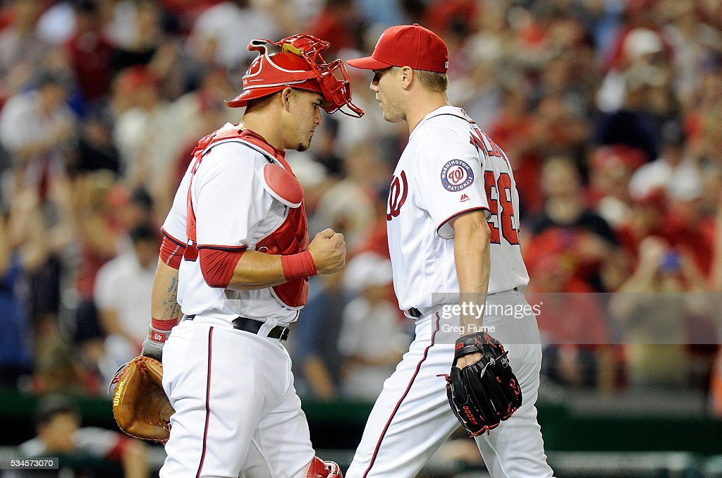<a gi-track='captionPersonalityLinkClicked' href=/galleries/search?phrase=Jonathan+Papelbon&family=editorial&specificpeople=453535 ng-click='$event.stopPropagation()'>Jonathan Papelbon</a> #58 of the Washington Nationals celebrates with <a gi-track='captionPersonalityLinkClicked' href=/galleries/search?phrase=Wilson+Ramos&family=editorial&specificpeople=4866956 ng-click='$event.stopPropagation()'>Wilson Ramos</a> #40 after a 2-1 victory against the St. Louis Cardinals at Nationals Park on May 26, 2016 in Washington, DC.