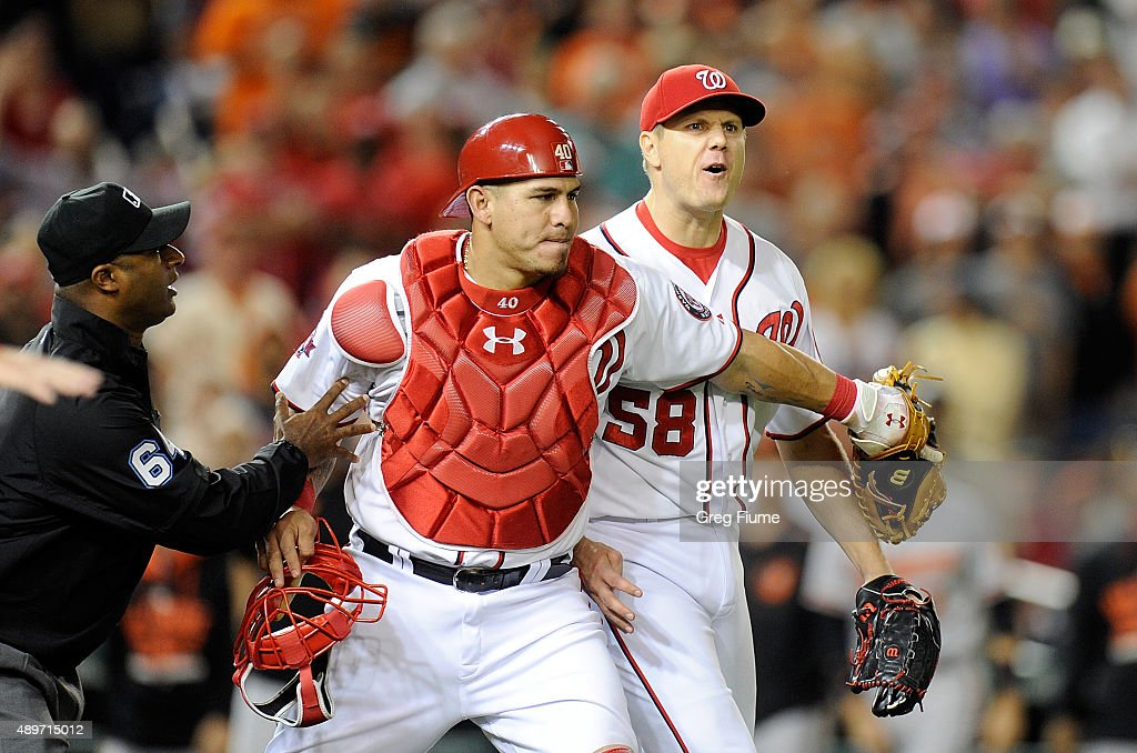 Jonathan Papelbon of the Washington Nationals is restrained by Wilson Ramos after being thrown out of the game in the ninth inning against the...