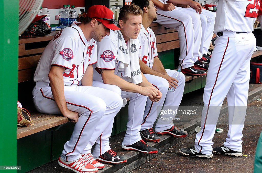 Jonathan Papelbon of the Washington Nationals talks with Max Scherzer in the dugout during the ninth inning against the Philadelphia Phillies at...