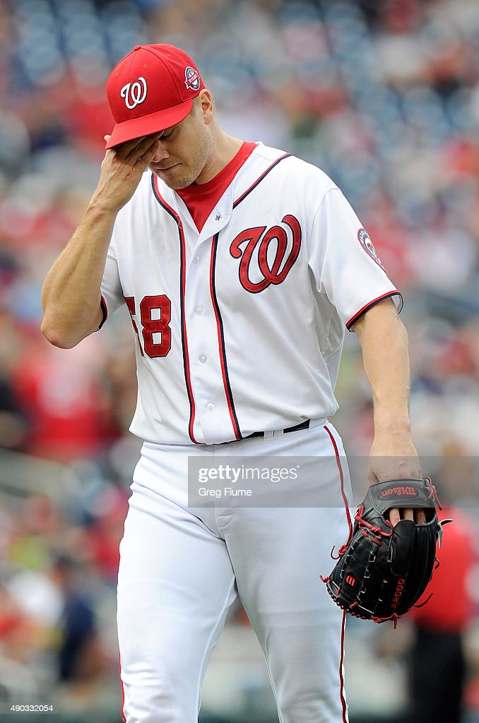 Jonathan Papelbon of the Washington Nationals walks to the dugout after being taken out of the game in the ninth inning against the Philadelphia...