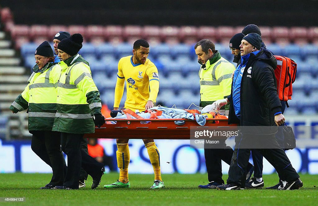 Jonathan Parr of Crystal Palace leaves the field on a stretcher during the Budweiser FA Cup fourth round match between Wigan Athletic and Crystal Palace at DW Stadium on January 25, 2014 in Wigan, England.