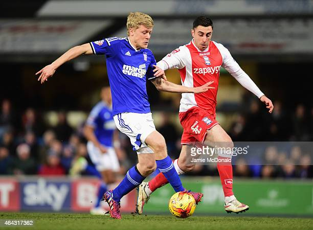 Jonathan Parr of Ipswich Town holds off Lee Novak of Birmingham City during the Sky Bet Championship match between Ipswich Town and Birmingham City...