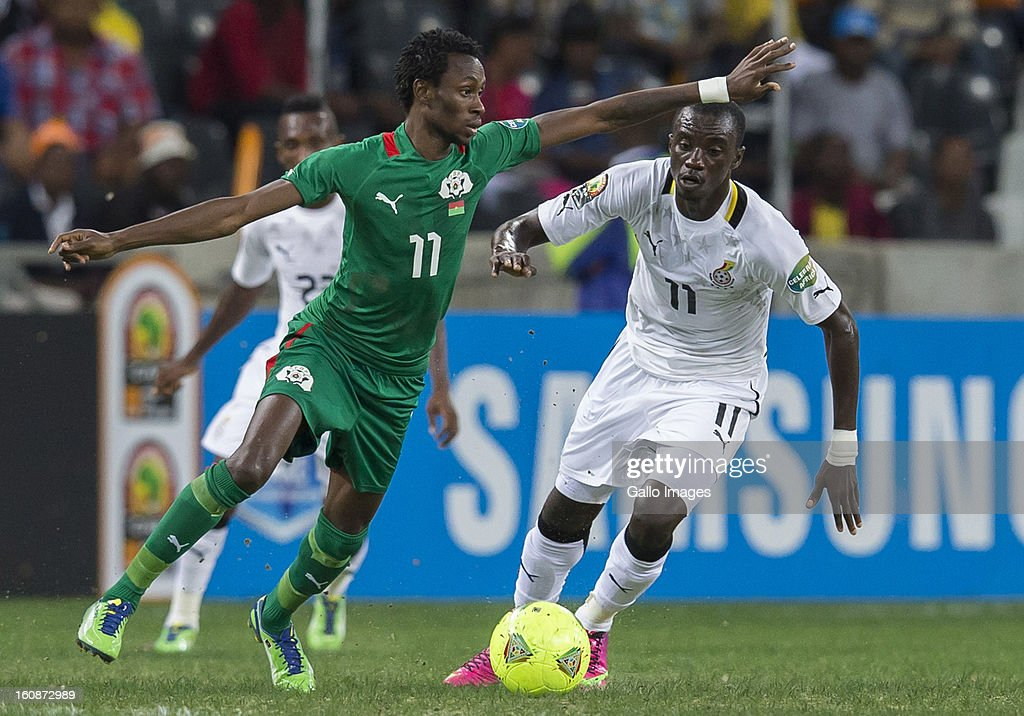 Jonathan Pitroipa from Burkina Faso (L) and Rabiu Alhassan Mohammed from Ghana (R) during the 2013 Orange African Cup of Nations 2nd Semi Final match between Burkina Faso and Ghana at Mbombela Stadium on February 06, 2013 in Nelspruit, South Africa.