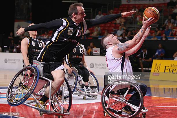 Jonathan Pollock of Great Britain scores a point as Dirk KohlerLenz of Germany attempts to block during the Great Britain versus Germany men's...
