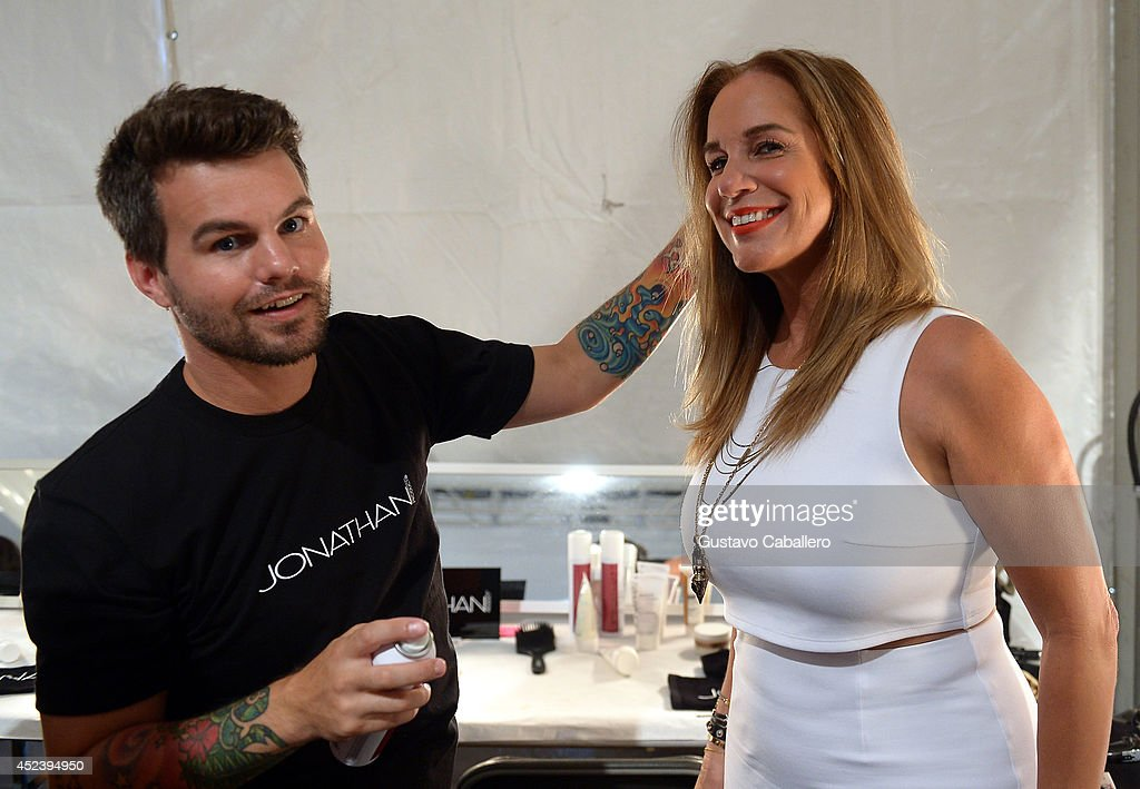 Jonathan Powell and Designer Monica Wise pose backstage at L*SPACE By Monica Wise with Jonathan Product during MercedesBenz Fashion Week Swim 2015 at...