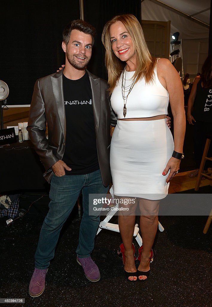 Jonathan Powell poses with Designer Monica Wise backstage at L*SPACE By Monica Wise with Jonathan Product during MercedesBenz Fashion Week Swim 2015...