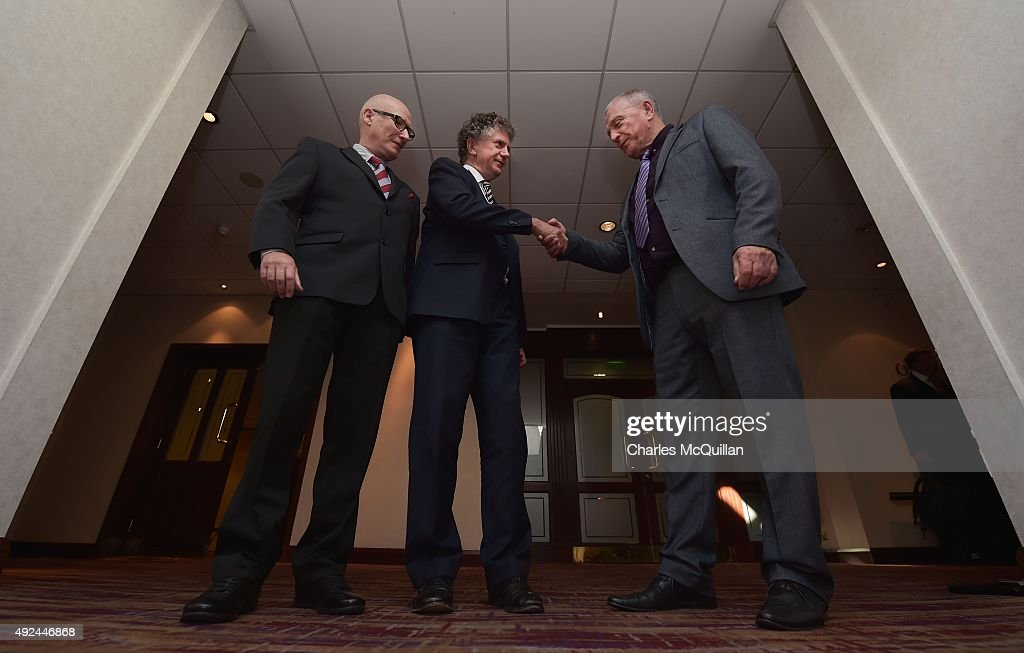 Jonathan Powell (2nd L) shakes hands with former UDA leader Jackie McDonald (R) alongside Billy Hutchinson (L), PUP leader at the launch of the Loyalist Community Council at the Park Avenue Hotel on October 13, 2015 in Belfast, Northern Ireland. The council has the backing of the three main loyalist paramilitary groups, the UVF, the UDA and the Red Hand Commandos. A joint statement from the three loyalist groups said that they are 're-committing to the principals of the Belfast Agreement' and that they 'eschew all violence and criminality'. The launch of the new loyalist community council comes against the backdrop of an ongoing crisis at Stormont following following allegations that the IRA were involved in the murder of their former member Kevin McGuigan.