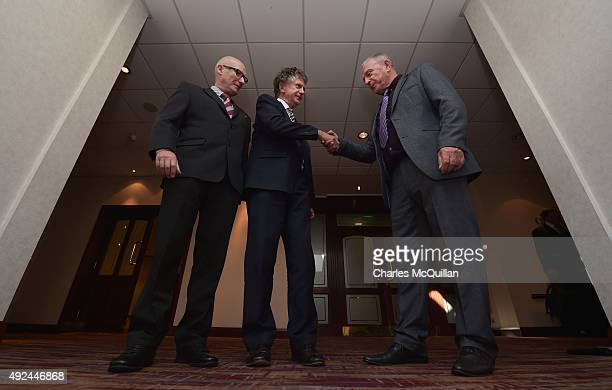 Jonathan Powell shakes hands with former UDA leader Jackie McDonald alongside Billy Hutchinson PUP leader at the launch of the Loyalist Community...