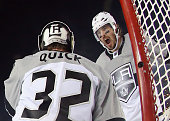 Jonathan Quick and Drew Doughty of the Los Angeles Kings celebrate their 21 victory over the San Jose Sharks in the 2015 Coors Light NHL Stadium...