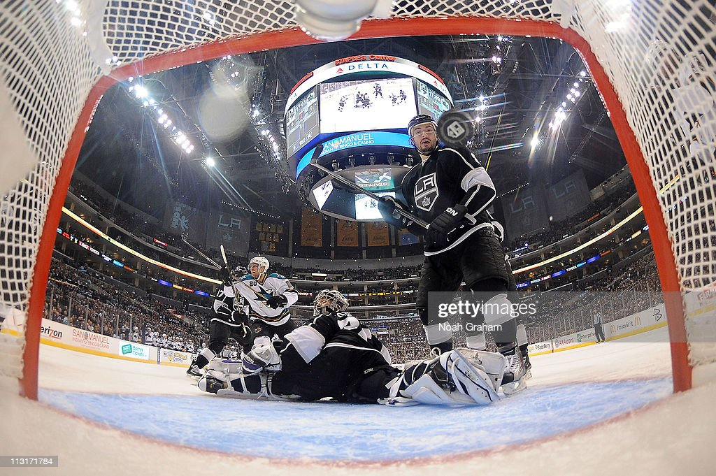 <a gi-track='captionPersonalityLinkClicked' href=/galleries/search?phrase=Jonathan+Quick&family=editorial&specificpeople=2271852 ng-click='$event.stopPropagation()'>Jonathan Quick</a> #32 and <a gi-track='captionPersonalityLinkClicked' href=/galleries/search?phrase=Drew+Doughty&family=editorial&specificpeople=2085761 ng-click='$event.stopPropagation()'>Drew Doughty</a> #8 of the Los Angeles Kings react as the puck goes in the net against the San Jose Sharks in Game Six of the Western Conference Quarterfinals during the 2011 NHL Stanley Cup Playoffs at Staples Center on April 25, 2011 in Los Angeles, California.