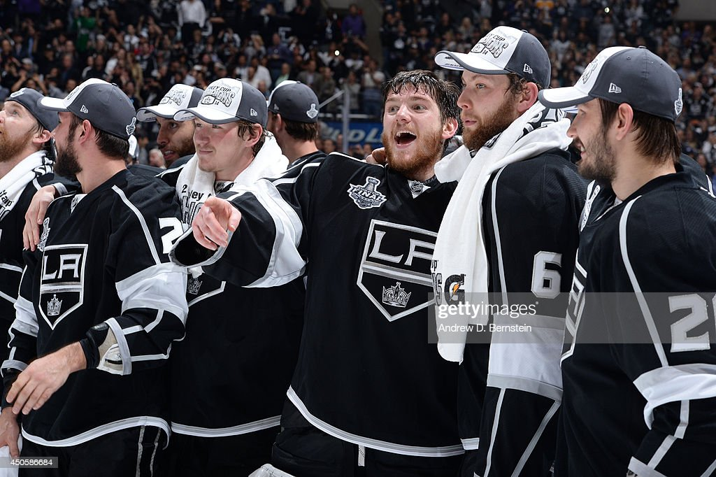 Jonathan Quick #32 and Jake Muzzin #6 of the Los Angeles Kings react after defeating the New York Rangers in the the second overtime period of Game Five of the 2014 NHL Stanley Cup Final at Staples Center on June 13, 2014 in Los Angeles, California.