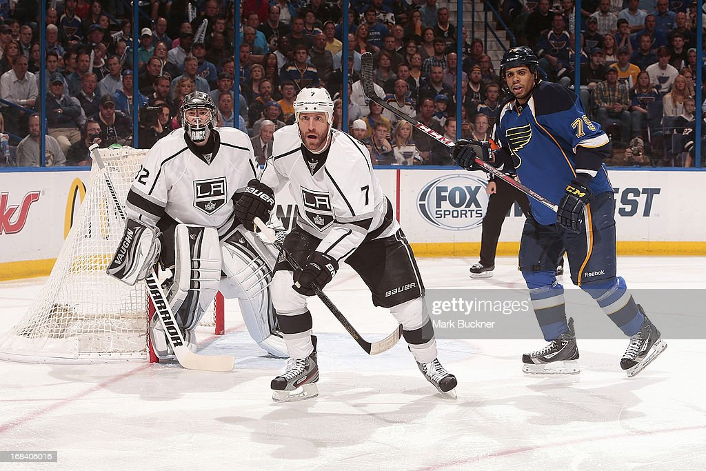 Jonathan Quick and Rob Scuderi of the Los Angeles Kings defend against Ryan Reaves of the St Louis Blues in Game Five of the Western Conference...