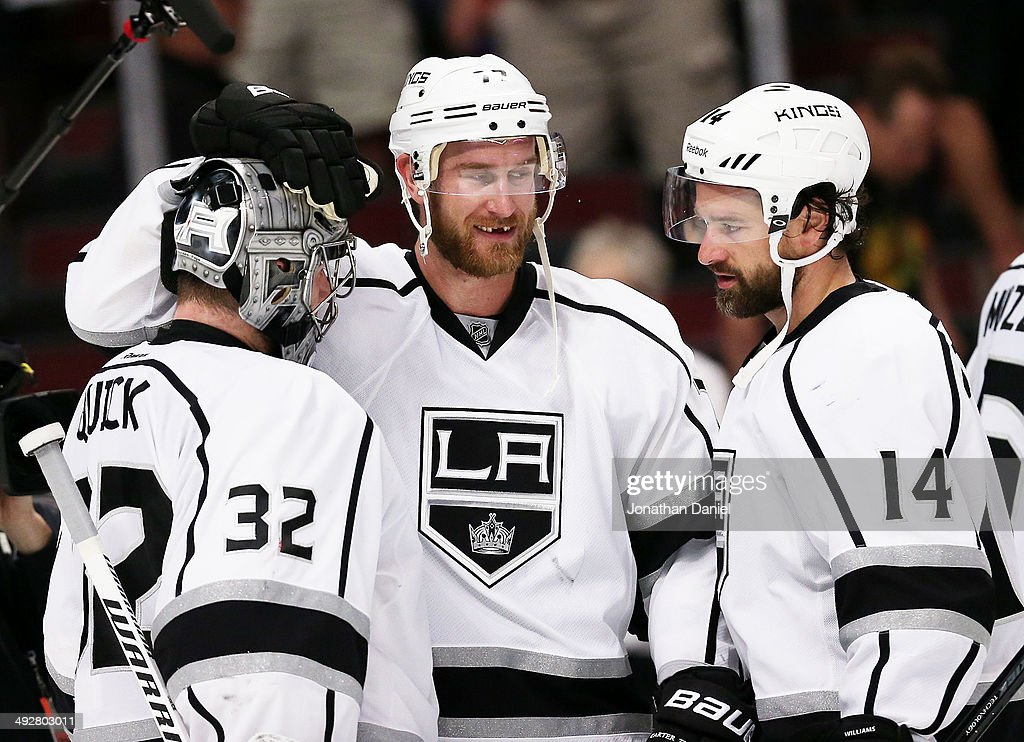 Jonathan Quick #32, Jeff Carter #77 and Justin Williams #14 of the Los Angeles Kings celebrate their 6 to 2 win over the Chicago Blackhawks in Game Two of the Western Conference Final during the 2014 Stanley Cup Playoffs at United Center on May 21, 2014 in Chicago, Illinois.