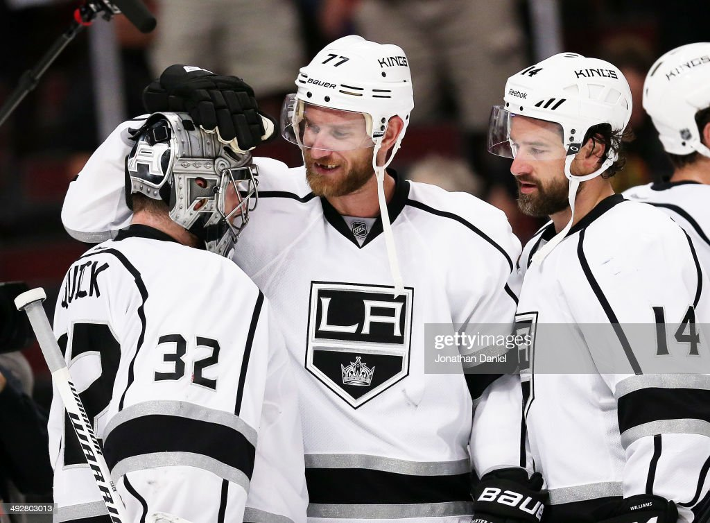 <a gi-track='captionPersonalityLinkClicked' href=/galleries/search?phrase=Jonathan+Quick&family=editorial&specificpeople=2271852 ng-click='$event.stopPropagation()'>Jonathan Quick</a> #32, <a gi-track='captionPersonalityLinkClicked' href=/galleries/search?phrase=Jeff+Carter&family=editorial&specificpeople=227320 ng-click='$event.stopPropagation()'>Jeff Carter</a> #77 and Justin Williams #14 of the Los Angeles Kings celebrate their 6 to 2 win over the Chicago Blackhawks in Game Two of the Western Conference Final during the 2014 Stanley Cup Playoffs at United Center on May 21, 2014 in Chicago, Illinois.