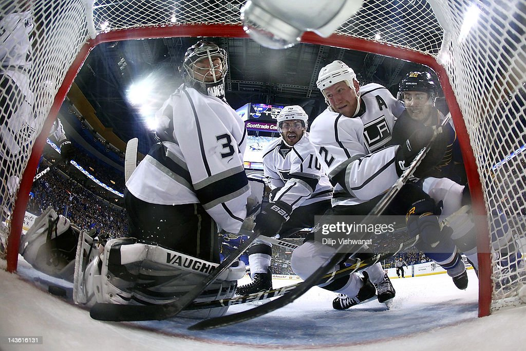 Jonathan Quick Matt Greene and Mike Richards all of the Los Angeles Kings stop the puck from crossing the goal line against Kevin Shattenkirk of the...