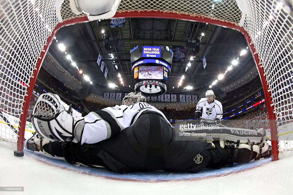 Jonathan Quick of the Los Angeles Kings allows a goal by Zach Parise of the New Jersey Devils in the first period during Game Five of the 2012 NHL...