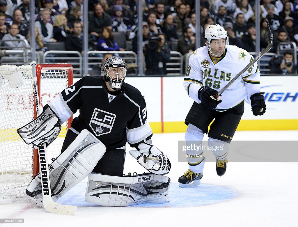 Jonathan Quick #32 of the Los Angeles Kings and Jaromir Jagr #68 of the Dallas Stars look for the puck during the third period at Staples Center on March 7, 2013 in Los Angeles, California. Jagr had two goals in the game and the Stars won 5-2.