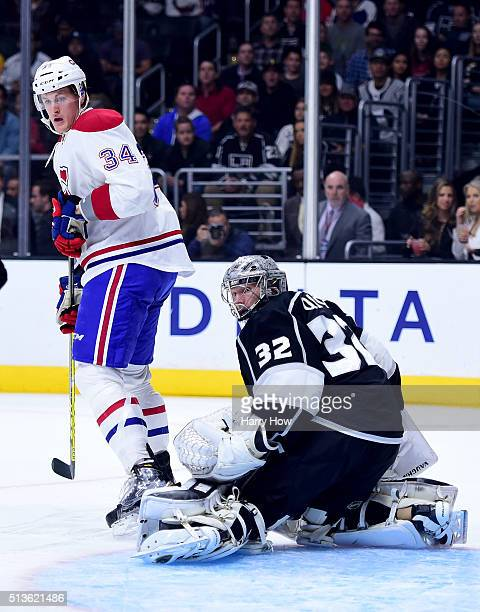 Jonathan Quick of the Los Angeles Kings and Michael McCarron of the Montreal Canadiens look for a rebound after a shot during the first period at...