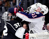 Jonathan Quick of the Los Angeles Kings and Scott Hartnell of the Columbus Blue Jackets get roughing penalties during the first period at Staples...