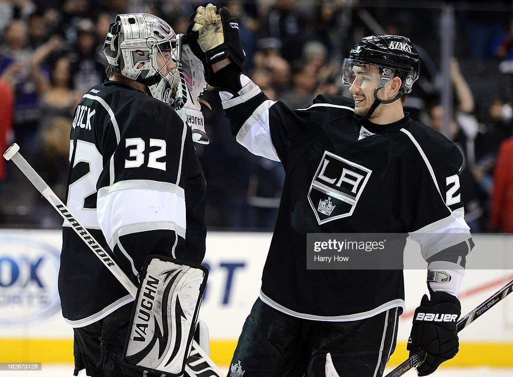 <a gi-track='captionPersonalityLinkClicked' href=/galleries/search?phrase=Jonathan+Quick&family=editorial&specificpeople=2271852 ng-click='$event.stopPropagation()'>Jonathan Quick</a> #32 of the Los Angeles Kings and <a gi-track='captionPersonalityLinkClicked' href=/galleries/search?phrase=Slava+Voynov&family=editorial&specificpeople=8315719 ng-click='$event.stopPropagation()'>Slava Voynov</a> #26 celebrate a 5-2 win over the Anaheim Ducks at Staples Center on February 25, 2013 in Los Angeles, California.