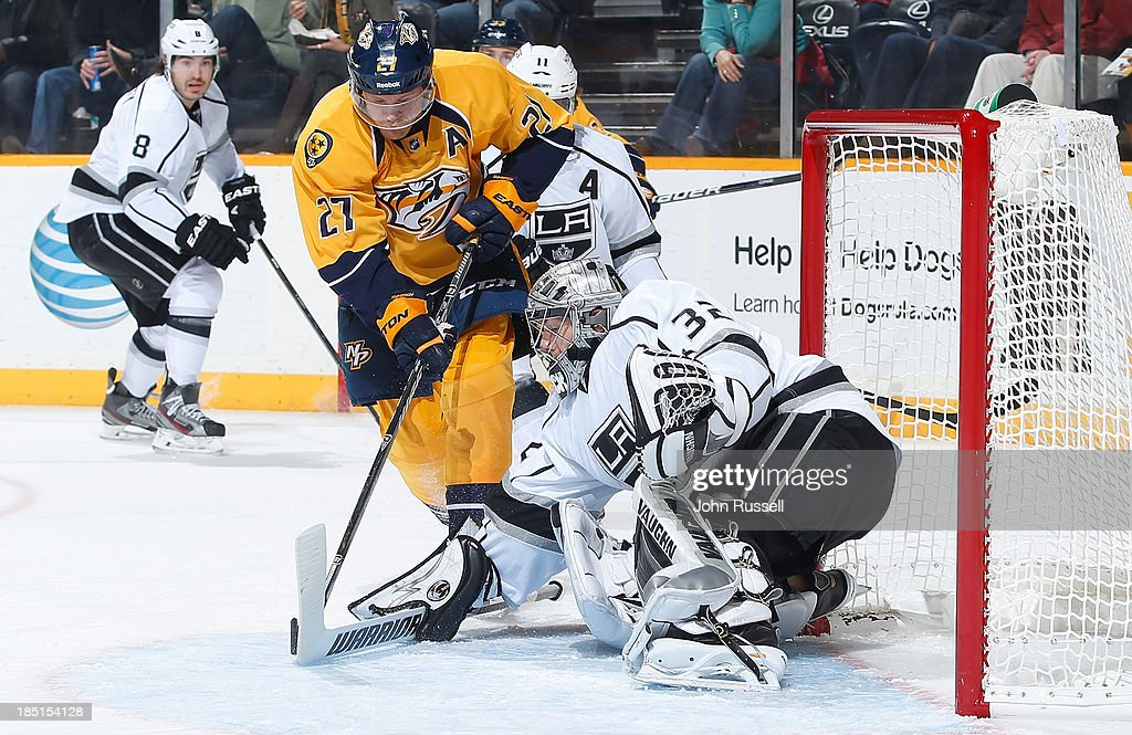 <a gi-track='captionPersonalityLinkClicked' href=/galleries/search?phrase=Jonathan+Quick&family=editorial&specificpeople=2271852 ng-click='$event.stopPropagation()'>Jonathan Quick</a> #32 of the Los Angeles Kings blocks a shot against <a gi-track='captionPersonalityLinkClicked' href=/galleries/search?phrase=Patric+Hornqvist&family=editorial&specificpeople=1966879 ng-click='$event.stopPropagation()'>Patric Hornqvist</a> #27 of the Nashville Predators at Bridgestone Arena on October 17, 2013 in Nashville, Tennessee.