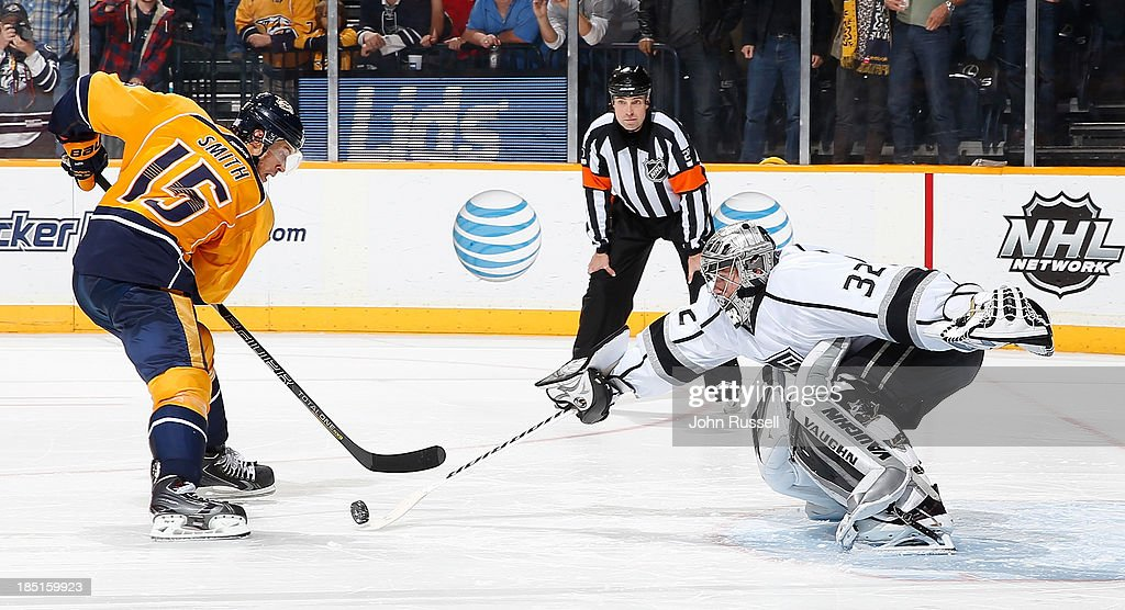 <a gi-track='captionPersonalityLinkClicked' href=/galleries/search?phrase=Jonathan+Quick&family=editorial&specificpeople=2271852 ng-click='$event.stopPropagation()'>Jonathan Quick</a> #32 of the Los Angeles Kings blocks the shot of Craig Smith #15 of the Nashville Predators during a shootout at Bridgestone Arena on October 17, 2013 in Nashville, Tennessee.