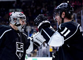 Jonathan Quick of the Los Angeles Kings celebrates the overtime goal of Anze Kopitar to beat the Vancouver Canucks 21 in overtime at Staples Center...