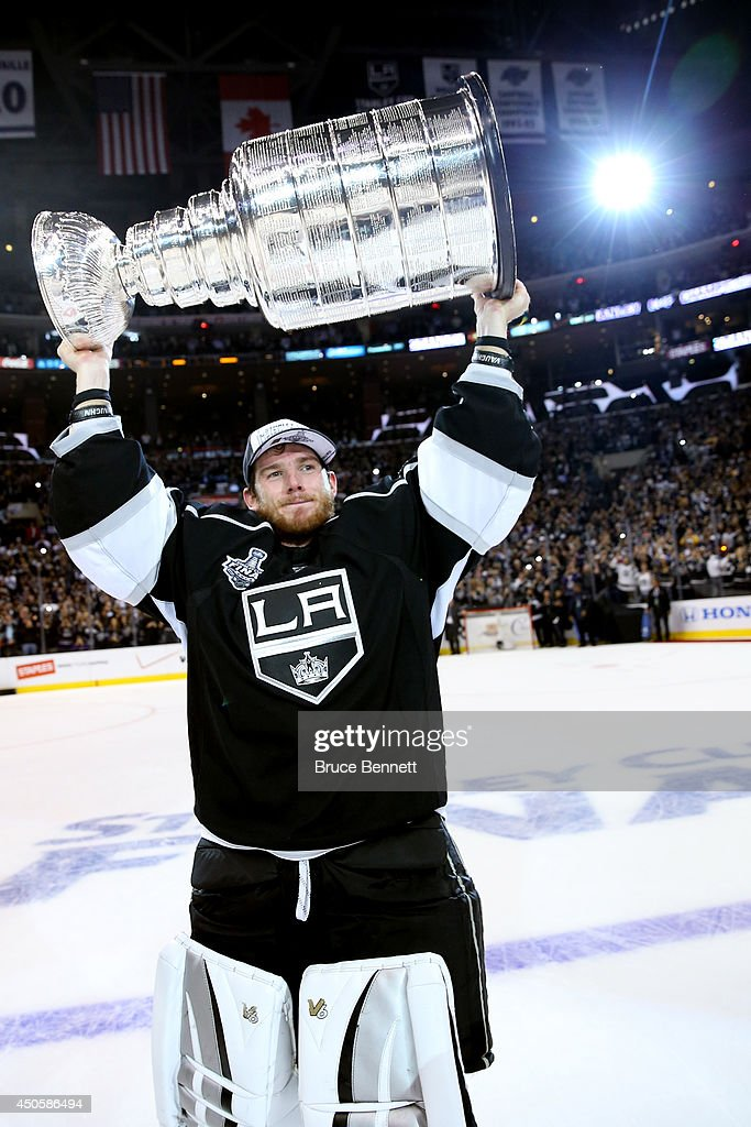 Jonathan Quick of the Los Angeles Kings celebrates with the Stanley Cup after the Kings 32 double overtime victory against the New York Rangers in...