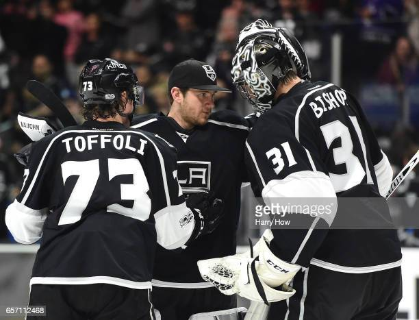 Jonathan Quick of the Los Angeles Kings congratulates Ben Bishop with Tyler Toffoli after a 52 Kings win over the Winnipeg Jets at Staples Center on...