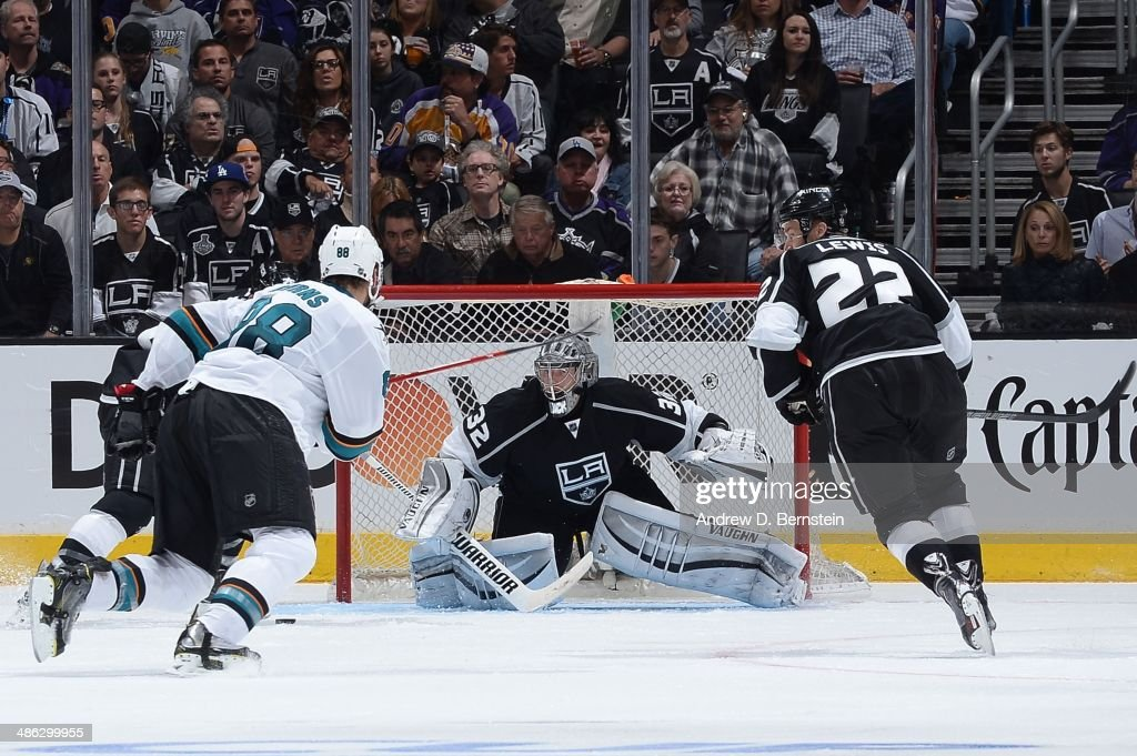Jonathan Quick of the Los Angeles Kings defends the goal against Brent Burns of the San Jose Sharks in Game Three of the First Round of the 2014...
