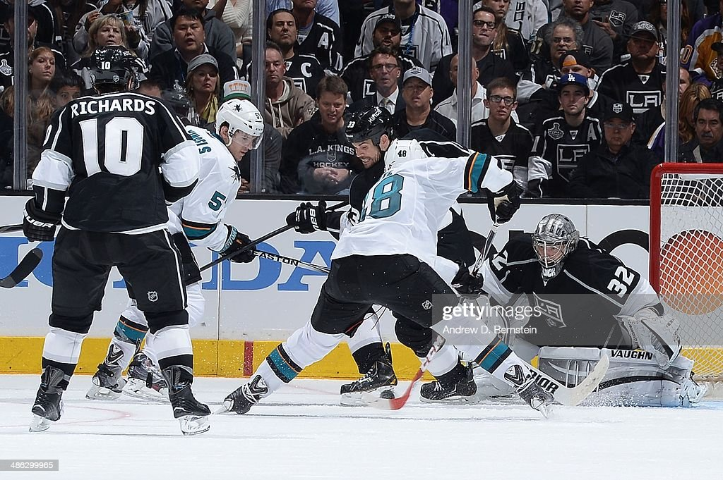<a gi-track='captionPersonalityLinkClicked' href=/galleries/search?phrase=Jonathan+Quick&family=editorial&specificpeople=2271852 ng-click='$event.stopPropagation()'>Jonathan Quick</a> #32 of the Los Angeles Kings defends the goal against <a gi-track='captionPersonalityLinkClicked' href=/galleries/search?phrase=Brent+Burns&family=editorial&specificpeople=212883 ng-click='$event.stopPropagation()'>Brent Burns</a> #88 of the San Jose Sharks in Game Three of the First Round of the 2014 Stanley Cup Playoffs at Staples Center on April 22, 2014 in Los Angeles, California.