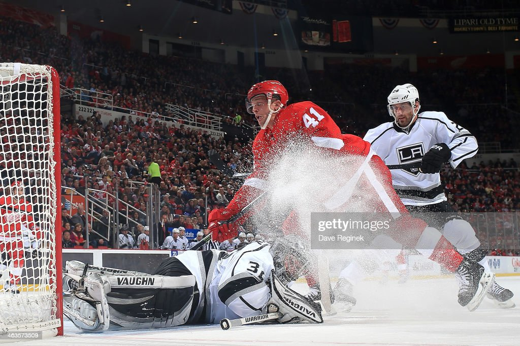<a gi-track='captionPersonalityLinkClicked' href=/galleries/search?phrase=Jonathan+Quick&family=editorial&specificpeople=2271852 ng-click='$event.stopPropagation()'>Jonathan Quick</a> #32 of the Los Angeles Kings dives on the puck sending <a gi-track='captionPersonalityLinkClicked' href=/galleries/search?phrase=Luke+Glendening&family=editorial&specificpeople=5650380 ng-click='$event.stopPropagation()'>Luke Glendening</a> #41 of the Detroit Red Wings flying over him during an NHL game on January 18, 2014 at Joe Louis Arena in Detroit, Michigan.