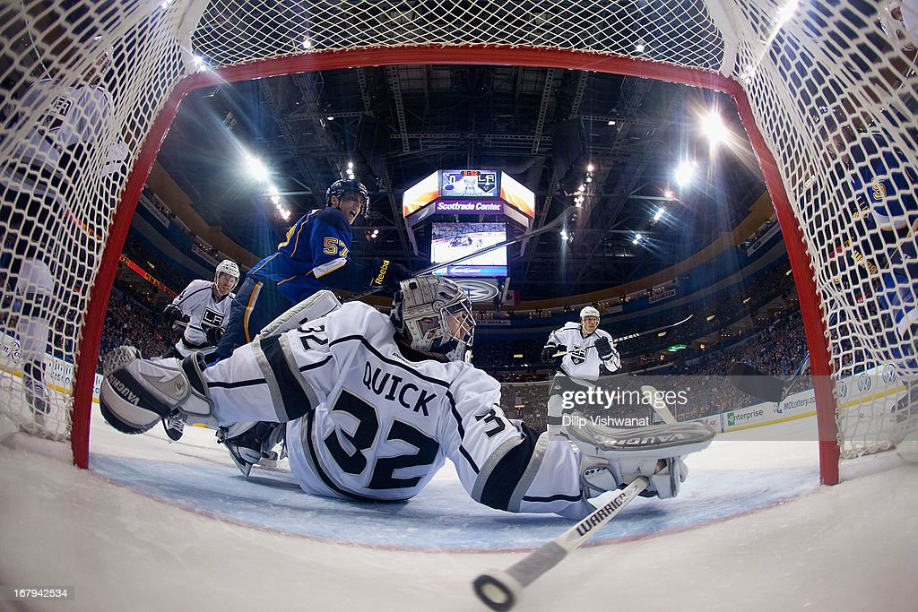 <a gi-track='captionPersonalityLinkClicked' href=/galleries/search?phrase=Jonathan+Quick&family=editorial&specificpeople=2271852 ng-click='$event.stopPropagation()'>Jonathan Quick</a> #32 of the Los Angeles Kings falls to the ice as <a gi-track='captionPersonalityLinkClicked' href=/galleries/search?phrase=David+Perron&family=editorial&specificpeople=4282591 ng-click='$event.stopPropagation()'>David Perron</a> #57 of the St. Louis Blues looks for a pass in Game Two of the Western Conference Quarterfinals during the 2013 NHL Stanley Cup Playoffs at the Scottrade Center on May 2, 2013 in St. Louis, Missouri. The Blues beat the Kings 2-1.