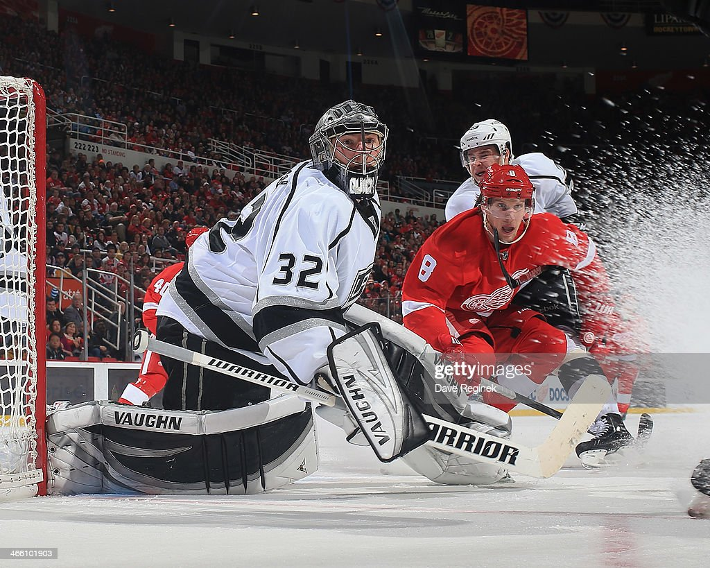 <a gi-track='captionPersonalityLinkClicked' href=/galleries/search?phrase=Jonathan+Quick&family=editorial&specificpeople=2271852 ng-click='$event.stopPropagation()'>Jonathan Quick</a> #32 of the Los Angeles Kings follows the play as teammate Dustin Brown #23 defend in front against <a gi-track='captionPersonalityLinkClicked' href=/galleries/search?phrase=Justin+Abdelkader&family=editorial&specificpeople=2271858 ng-click='$event.stopPropagation()'>Justin Abdelkader</a> #8 of the Detroit Red Wings during an NHL game on January 18, 2014 at Joe Louis Arena in Detroit, Michigan. The Red Wings defeated the Kings 3-2 in a shootout