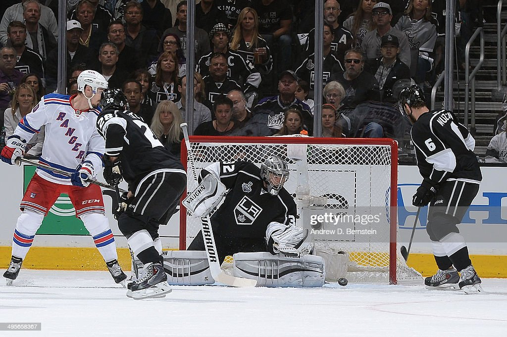 Jonathan Quick of the Los Angeles Kings gives up goal against the New York Rangers in Game One of the Stanley Cup Final during the 2014 Stanley Cup...