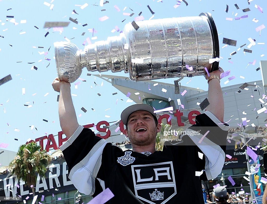 Jonathan Quick of the Los Angeles Kings holds up the Stanley Cup during the Los Angeles Kings Victory Parade And Rally on June 16 2014 in Los Angeles...