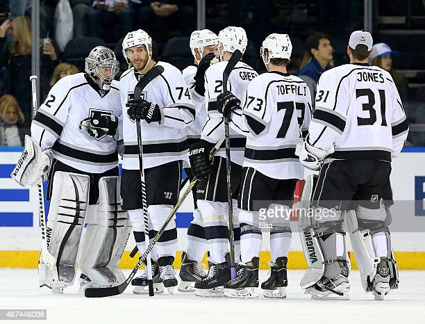 Jonathan Quick of the Los Angeles Kings is congratulated by Dwight King and the rest of his teammates after the win over the New York Rangers on...