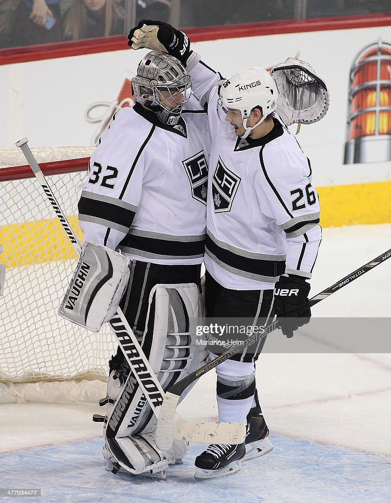 <a gi-track='captionPersonalityLinkClicked' href=/galleries/search?phrase=Jonathan+Quick&family=editorial&specificpeople=2271852 ng-click='$event.stopPropagation()'>Jonathan Quick</a> #32 of the Los Angeles Kings is congratulated by teammate <a gi-track='captionPersonalityLinkClicked' href=/galleries/search?phrase=Slava+Voynov&family=editorial&specificpeople=8315719 ng-click='$event.stopPropagation()'>Slava Voynov</a> #26 at the end of an NHL game at the MTS Centre on March 6, 2014 in Winnipeg, Manitoba, Canada.