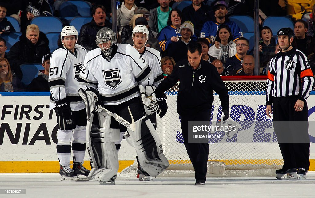 Jonathan Quick #32 of the Los Angeles Kings is injured and leaves the game during the third period against the Buffalo Sabres at the First Niagara Center on November 12, 2013 in Buffalo, New York.