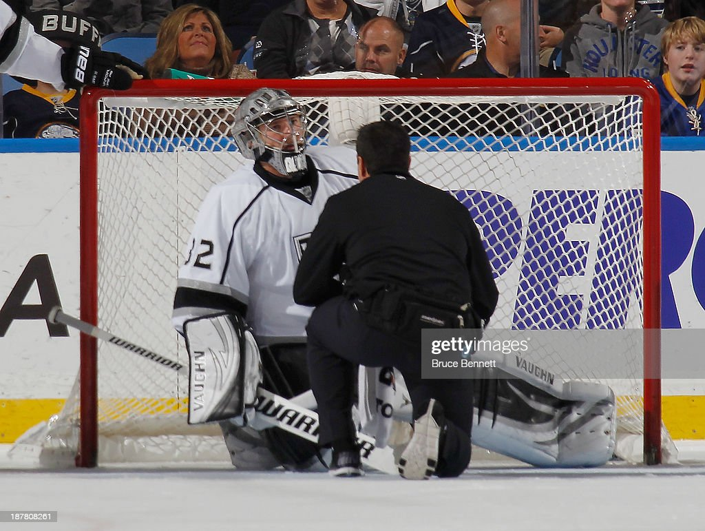Jonathan Quick #32 of the Los Angeles Kings is injured in the third period during the game against the Buffalo Sabres at the First Niagara Center on November 12, 2013 in Buffalo, New York.