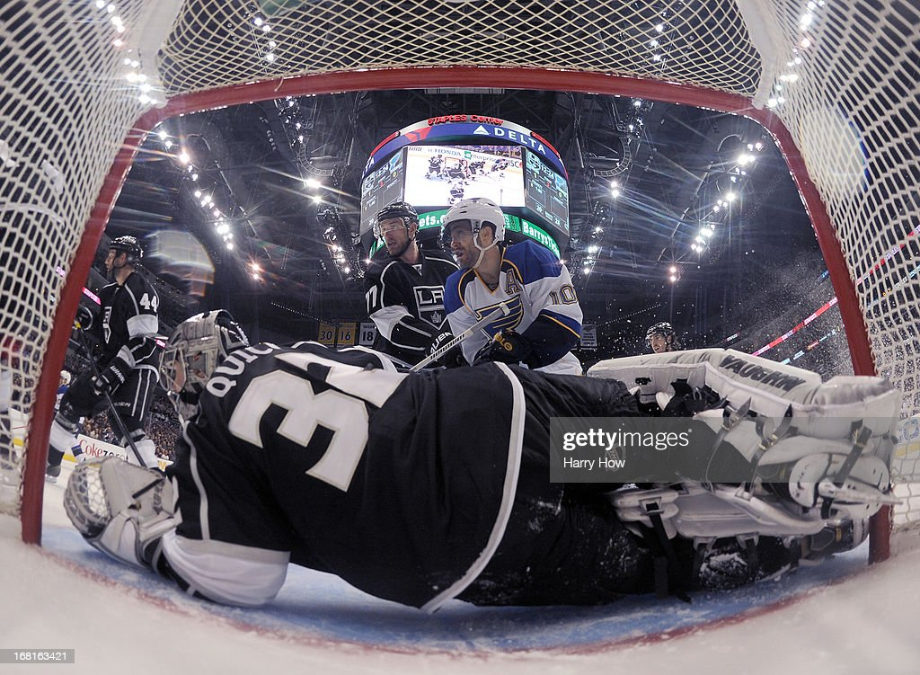 <a gi-track='captionPersonalityLinkClicked' href=/galleries/search?phrase=Jonathan+Quick&family=editorial&specificpeople=2271852 ng-click='$event.stopPropagation()'>Jonathan Quick</a> #32 of the Los Angeles Kings lays across the crease in front of Andy McDonald #10 of the St. Louis Blues and <a gi-track='captionPersonalityLinkClicked' href=/galleries/search?phrase=Jeff+Carter&family=editorial&specificpeople=227320 ng-click='$event.stopPropagation()'>Jeff Carter</a> #77 of the Los Angeles Kings in Game Three of the Western Conference Quarterfinals during the 2013 NHL Stanley Cup Playoffs at Staples Center on May 4, 2013 in Los Angeles, California.