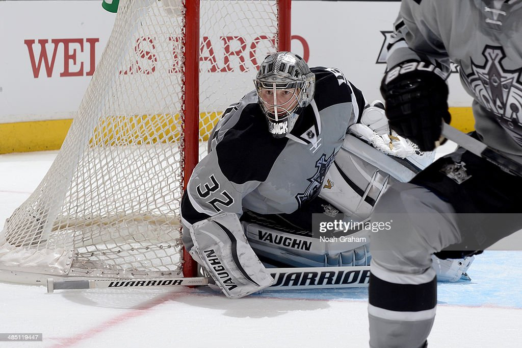 Jonathan Quick #32 of the Los Angeles Kings looks for the puck against the Anaheim Ducks at Staples Center on April 12, 2014 in Los Angeles, California.