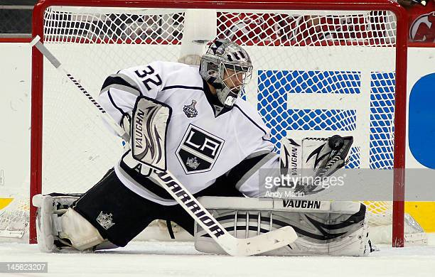Jonathan Quick of the Los Angeles Kings makes a glove save against the New Jersey Devils in Game Two of the 2012 NHL Stanley Cup Final at the...
