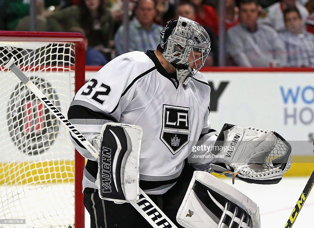 <a gi-track='captionPersonalityLinkClicked' href=/galleries/search?phrase=Jonathan+Quick&family=editorial&specificpeople=2271852 ng-click='$event.stopPropagation()'>Jonathan Quick</a> #32 of the Los Angeles Kings makes a glove save against the Chicago Blackhawks at the United Center on March 14, 2016 in Chicago, Illinois.
