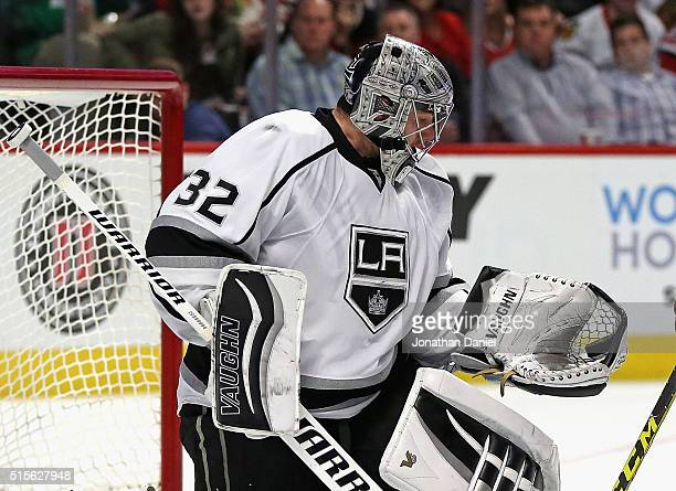 Jonathan Quick of the Los Angeles Kings makes a glove save against the Chicago Blackhawks at the United Center on March 14 2016 in Chicago Illinois