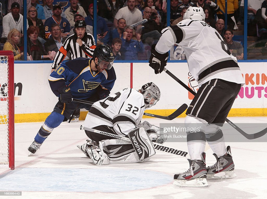 Jonathan Quick #32 of the Los Angeles Kings makes a glove save as Andy McDonald #10 of the St. Louis Blues looks for the rebound in Game Five of the Western Conference Quarterfinals during the 2013 NHL Stanley Cup Playoffs on May 8, 2013 at Scottrade Center in St. Louis, Missouri.