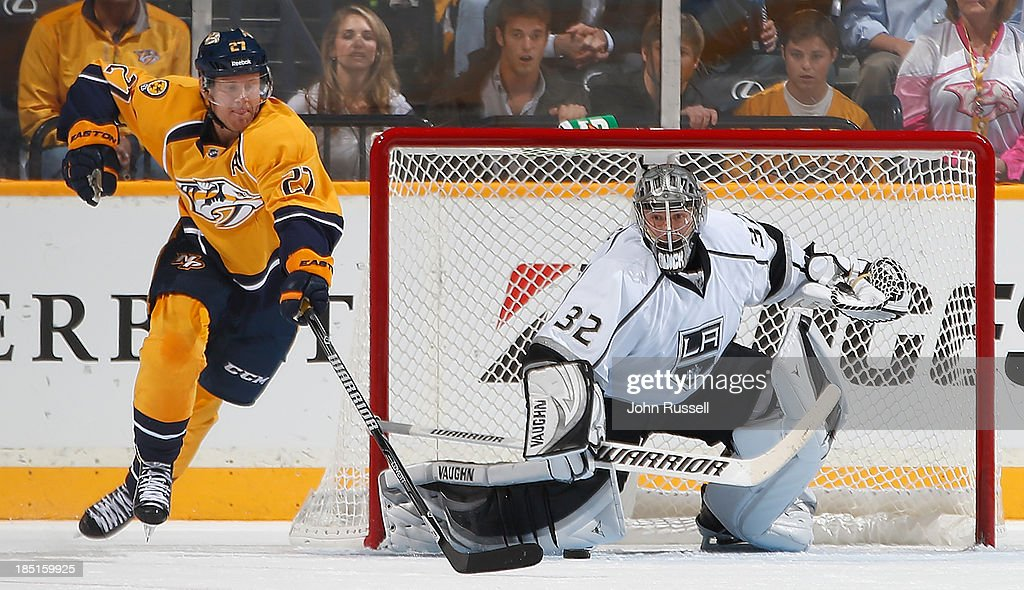 <a gi-track='captionPersonalityLinkClicked' href=/galleries/search?phrase=Jonathan+Quick&family=editorial&specificpeople=2271852 ng-click='$event.stopPropagation()'>Jonathan Quick</a> #32 of the Los Angeles Kings makes a pad save against <a gi-track='captionPersonalityLinkClicked' href=/galleries/search?phrase=Patric+Hornqvist&family=editorial&specificpeople=1966879 ng-click='$event.stopPropagation()'>Patric Hornqvist</a> #27 of the Nashville Predators at Bridgestone Arena on October 17, 2013 in Nashville, Tennessee.