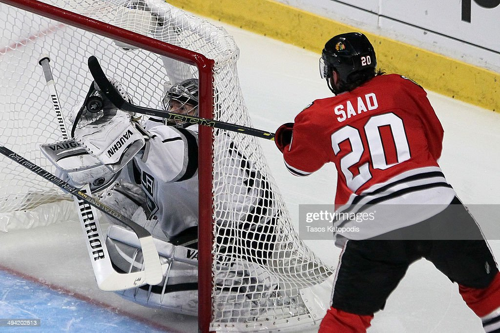 <a gi-track='captionPersonalityLinkClicked' href=/galleries/search?phrase=Jonathan+Quick&family=editorial&specificpeople=2271852 ng-click='$event.stopPropagation()'>Jonathan Quick</a> #32 of the Los Angeles Kings makes a save against <a gi-track='captionPersonalityLinkClicked' href=/galleries/search?phrase=Brandon+Saad&family=editorial&specificpeople=7128385 ng-click='$event.stopPropagation()'>Brandon Saad</a> #20 of the Chicago Blackhawks in the second period during Game Five of the Western Conference Final in the 2014 Stanley Cup Playoffs at United Center on May 28, 2014 in Chicago, Illinois.